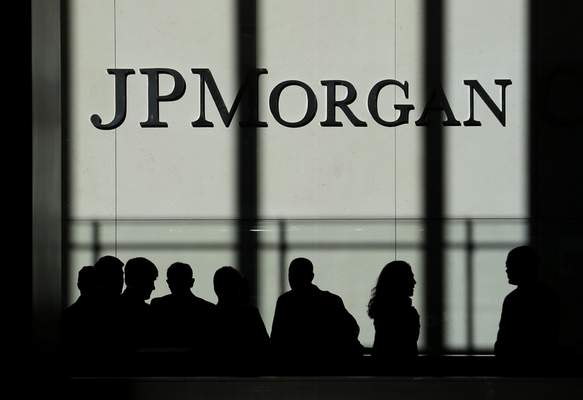 Associated Press photos JPMorgan Chase reported Tuesday that its fourth-quarter profits were 21% higher in 2019 than a year earlier. The banking giant had a record year in profits and revenue.