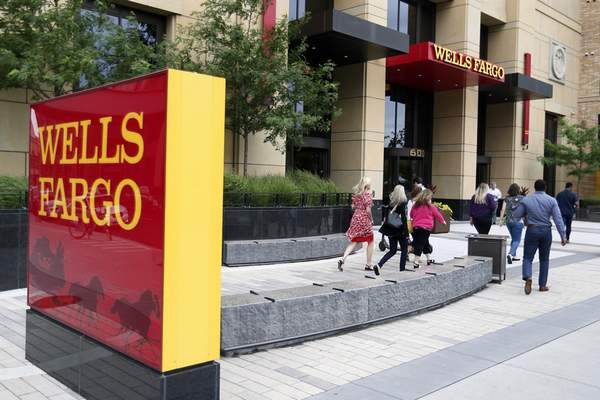Burdened by financial restrictions following years of missteps, Wells Fargo's profit fell in the fourth quarter of 2019, earning $2.87 billion.
