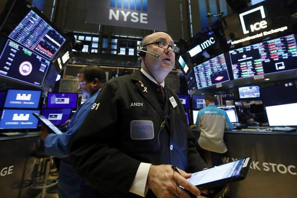 FILE - In this Jan. 10, 2020, file photo trader Andrew Silverman works on the floor of the New York Stock Exchange. (AP Photo/Richard Drew)