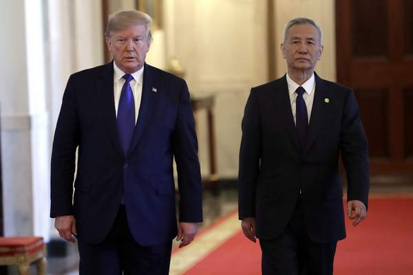 President Donald Trump walks with Chinese Vice Premier Liu He, left, to the East Room of the White House, Wednesday, Jan. 15, 2019, in Washington, to sign a trade agreeement. (AP Photo/ Evan Vucci)