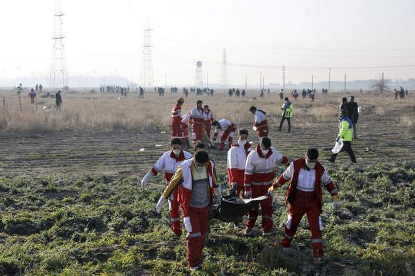 Rescue workers recover the bodies of victims of a Ukrainian plane crash in Shahedshahr, southwest of the capital Tehran, Iran, Wednesday, Jan. 8, 2020. (AP Photo/Ebrahim Noroozi)