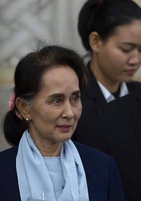 Myanmar's leader Aung San Suu Kyi leaves the International Court of Justice after addressing judges on the second day of three days of hearings in The Hague, Netherlands, Wednesday, Dec. 11, 2019. (AP Photo/Peter Dejong)