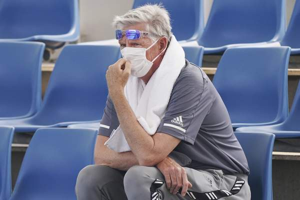A spectator wears a mask as smoke haze shrouds Melbourne during an Australian Open practice session at Melbourne Park in Australia, Tuesday, Jan. 14, 2020. (Michael Dodge/AAP Image via AP)