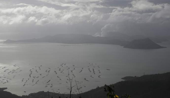 Taal volcano continues to spew ash as seen from Tagaytay, Cavite province, southern Philippines on Wednesday Jan. 15, 2020. (AP Photo/Aaron Favila)