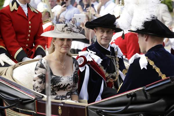 FILE - In this Monday, June 18, 2018 file photo, Britain's Prince Edward, center, in his roles as Knight Companion and his wife Sophie, Countess of Wessex, leave in a carriage after the Order of The Garter Service at Windsor Castle in Windsor, England. (AP Photo/Matt Dunham, Pool, File)