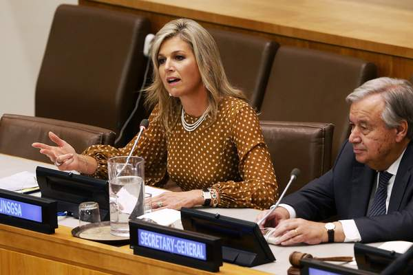 FILE - In this Wednesday, Sept. 25, 2019 file photo, Queen Maxima of the Netherlands is joined by United Nations Secretary-General Antonio Guterres as she delivers remarks at a side event regarding financial inclusion for development during the 74th session of the U.N. General Assembly, at U.N. headquarters. (AP Photo/Jason DeCrow, File)