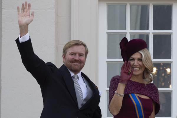 FILE - In this Tuesday, Sept. 17, 2019 file photo, Dutch King Willem-Alexander and Queen Maxima wave from the balcony of royal palace Noordeinde in The Hague, Netherlands. (AP Photo/Peter Dejong, File)