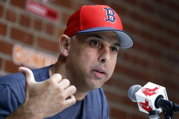 FILE – In this Sept. 9, 2019, file photo, Boston Red Sox manager Alex Cora talks about the dismissal of president of baseball operations Dave Dombrowski, during a news conference before the team's baseball game against the New York Yankees in Boston. (AP Photo/Michael Dwyer, File)