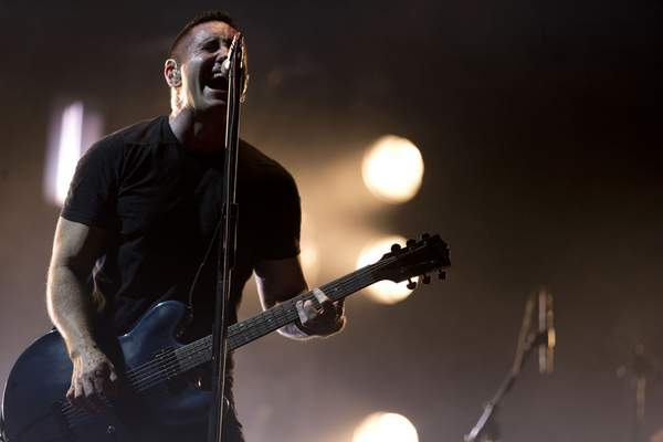 FILE - In this March 27, 2014 file photo, Trent Reznor of Nine Inch Nails performs at the Vive Latino music festival in Mexico City, Mexico. The band will be inducted into the Rock and Roll Hall of Fame. (AP Photo/Rebecca Blackwell, File)