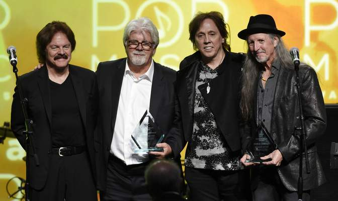FILE - This April 29, 2015 file photo shows from left, Tom Johnston, Michael McDonald, John McFee and Pat Simmons of the Doobie Brothers after receiving the ASCAP Voice of Music Award at the 32nd Annual ASCAP Pop Music Awards in Los Angeles. (Photo by Chris Pizzello/Invision/AP, File)