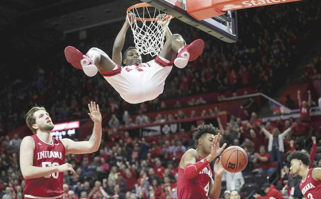 Associated Press Rutgers guard Montez Mathis hangs on the rim following a first-half dunk against the Hoosiers in Piscataway, N.J. With the win Wednesday night, the Scarlet Knights improved to 12-0 at home this year.