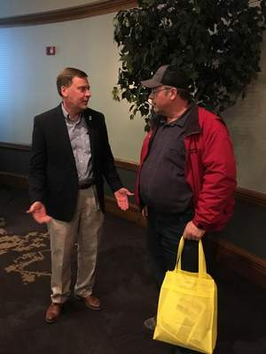 Rosa Salter-Rodriguez | The Journal Gazette Kendell Culp, left, vice president of the Indiana Farm Bureau, talks to Don Stadler at the Farm Show at Memorial Coliseum on Wednesday.