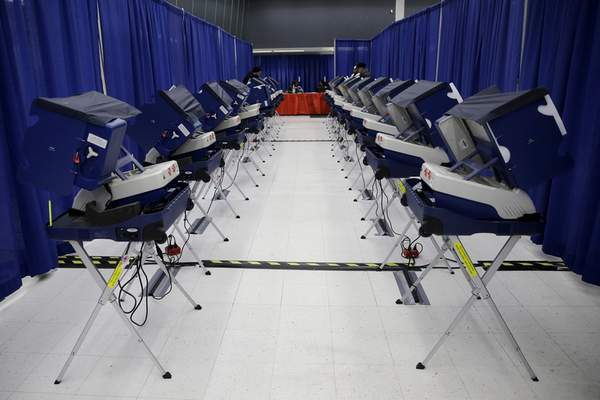 FILE - In this March 13, 2018, file photo, voters cast their ballots in Illinois primary elections at the city's new early voting super site in downtown Chicago. (AP Photo/Kiichiro Sato, File)