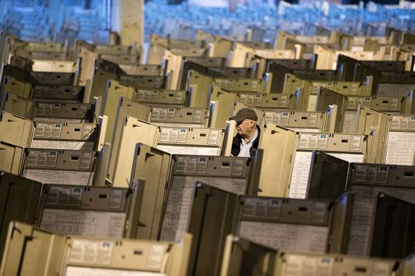 FILE- In this Oct. 14, 2016, file photo, a technician works to prepare voting machines to be used in the presidential election, in Philadelphia. (AP Photo/Matt Rourke, File)