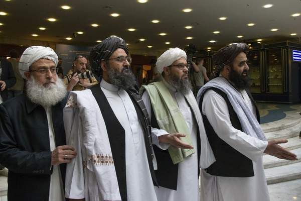 FILE - In this May 28, 2019, file photo, Mullah Abdul Ghani Baradar, the Taliban group's top political leader, second left, arrives with other members of the Taliban delegation for talks in Moscow, Russia. (AP Photo/Alexander Zemlianichenko, File)