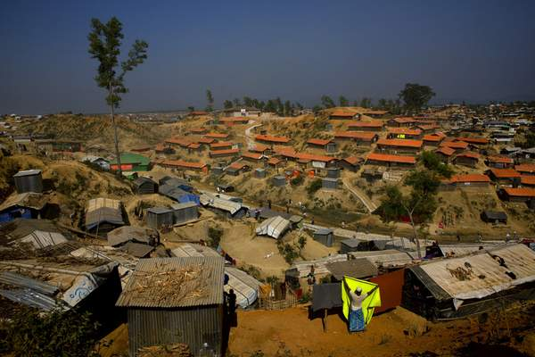 FILE - In this Jan. 23, 2018 file photo, a Rohingya refugee hangs a blanket out to dry at Balukhali refugee camp, about 50 kilometers (32 miles) from Cox's Bazar, Bangladesh. (AP Photo/Manish Swarup, File)