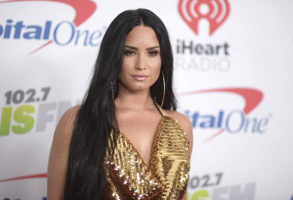 FILE - In this Dec. 1, 2017 file photo, Demi Lovato arrives at Jingle Ball at The Forum in Inglewood, Calif.  (Photo by Richard Shotwell/Invision/AP, File)