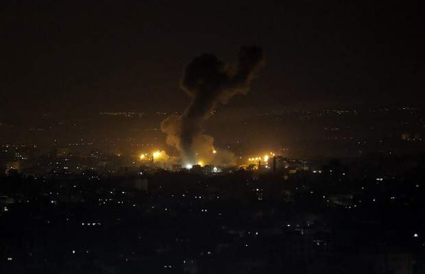 An explosion caused by Israeli airstrikes is seen on Gaza City, Wednesday, Jan. 15, 2020. (AP Photo/Adel Hana)