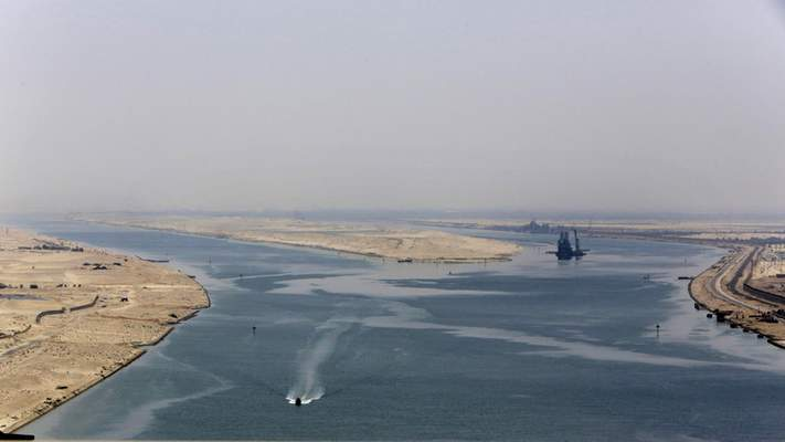 FILE - In this Aug. 6, 2015 file photo, an army zodiac secures the entrance of the new section of the Suez Canal in Ismailia, Egypt. (AP Photo/Amr Nabil, File)