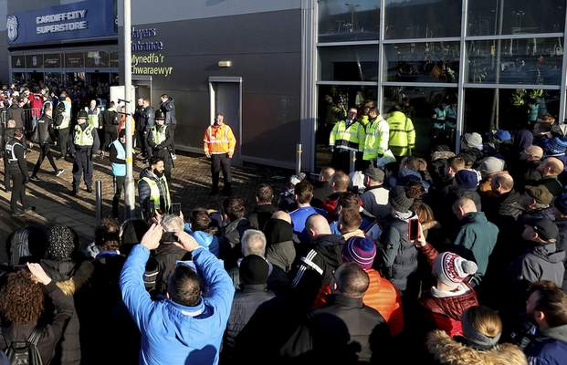 FILE - In this file photo dated Sunday Jan. 12, 2020, soccer fans crowd outside the Cardiff City soccer stadium ahead of the English Championship match against Swansea City, in Cardiff, Wales, as South Wales police are scheduled to test live facial recognition technology to monitor arriving fans for the soccer game. (David Davies/PA via AP)