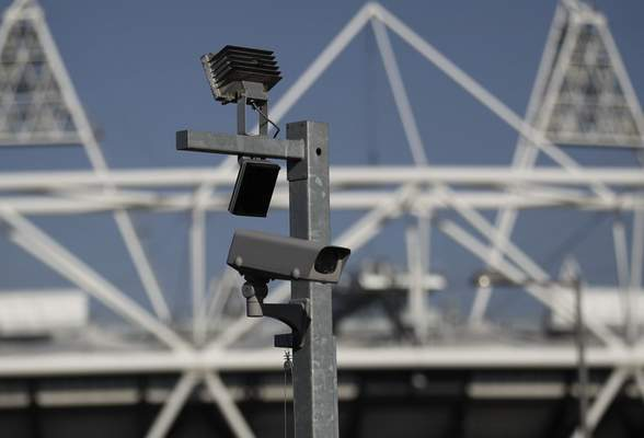 FILE - In this file photo dated Wednesday, March 28, 2012, a security cctv camera is seen by the Olympic Stadium at the Olympic Park in London. (AP Photo/Sang Tan, FILE)