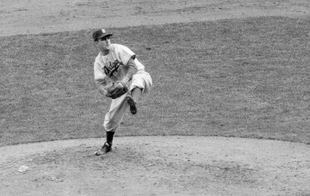 FILE - In this October 1952 file photo, Brooklyn Dodgers' Carl Erskine pitches against the New York Yankees in Game 5 of the baseball World Series in New York. (AP Photo, File)
