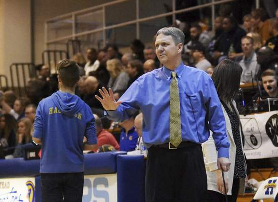 Katie Fyfe | The Journal Gazette  Homestead girls basketball coach Rod Parker returns to lead his team to victory after having health complications.