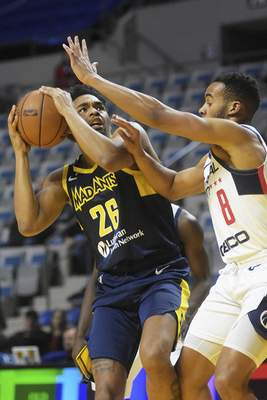Katie Fyfe | The Journal Gazette The Mad Ants' Ben Mooreprepares to shoot while the Capital City Go-Go's Phil Booth defends during the first quarter at Memorial Coliseum on Monday.