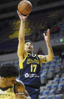 Katie Fyfe | The Journal Gazette  The Mad Ants' Stephan Hicks shoots during the first period against the Capital City Go-Go at Memorial Coliseum on Monday.