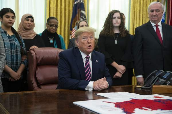 Associated Press President Donald Trump speaks during an event on prayer in public schools in the Oval Office of the White House on Thursday.