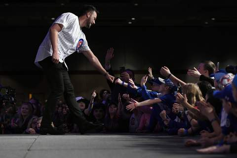 Chicago Cubs Convention Baseball Chicago Cubs' Kris Bryant, left, fist-bumps fans after being announced during the baseball team's convention, Friday, Jan. 17, 2020, in Chicago. (AP Photo/Paul Beaty) (Paul Beaty