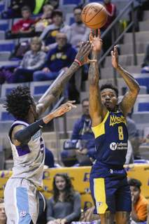 Mike Moore | The Journal Gazette  Mad Ants guard Daxter Miles Jr. takes a shot in the second quarter against Greensboro at Memorial Coliseum on Friday.