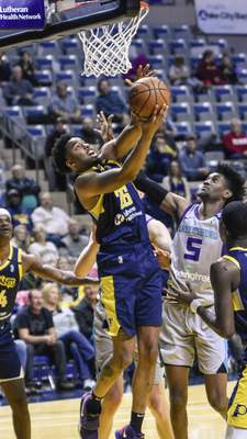 Mike Moore | The Journal Gazette Mad Ants forward Ben Moore goes up under the basket in the first quarter against Greensboro at Memorial Coliseum on Friday.