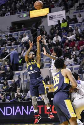 Mike Moore | The Journal Gazette  Mad Ants guard Walt Lemon Jr. takes a shot in the first quarter against Greensboro at Memorial Coliseum on Friday.