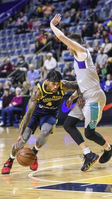 Mike Moore | The Journal Gazette Mad Ants guard Walt Lemon Jr. drives to the basket in the first quarter against Greensboro at Memorial Coliseum on Friday.