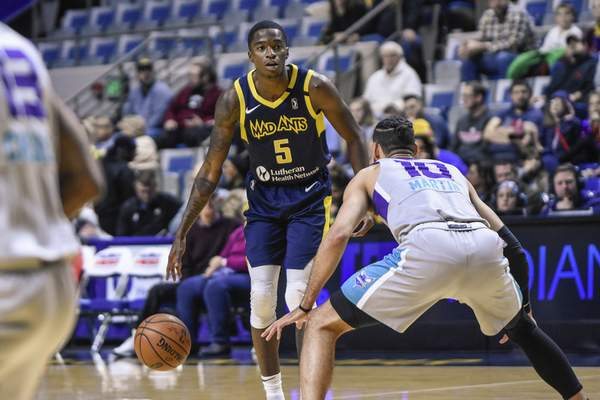 Mike Moore | The Journal Gazette  Mad Ants guard Edmond Sumnerlooks to make a play in the first quarter against Greensboro at Memorial Coliseum on Friday.