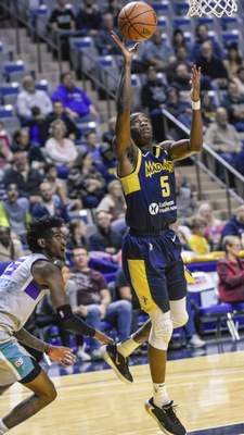 Mike Moore | The Journal Gazette Mad Ants guard Edmond Sumner scores under the basket in the first quarter against Greensboro at Memorial Coliseum on Friday.