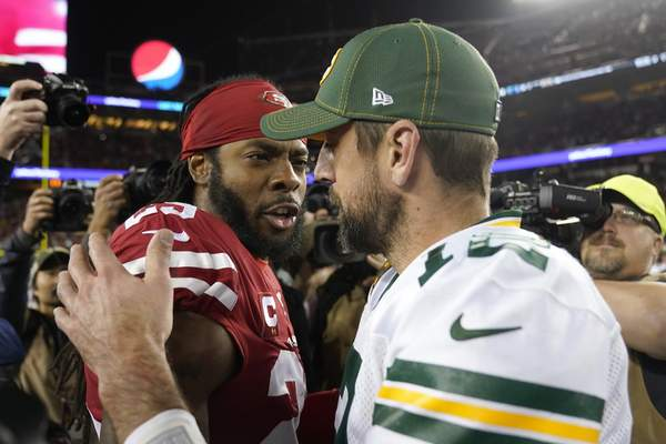 Associated Press San Francisco 49ers cornerback Richard Sherman greets Green Bay Packers quarterback Aaron Rodgers after the teams met in November. The two have nothing but respect for each other.