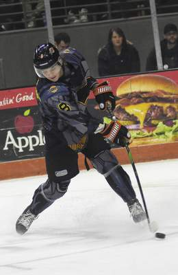 Katie Fyfe | The Journal Gazette  Komets forward Drake Rymsha shoots and scores during the second period against the Toledo Walleye at Memorial Coliseum on Saturday.