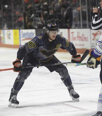 Katie Fyfe | The Journal Gazette  Komets forward A.J. Jenks prepares for a faceoff during the first period against the Toledo Walleye at Memorial Coliseum on Saturday.