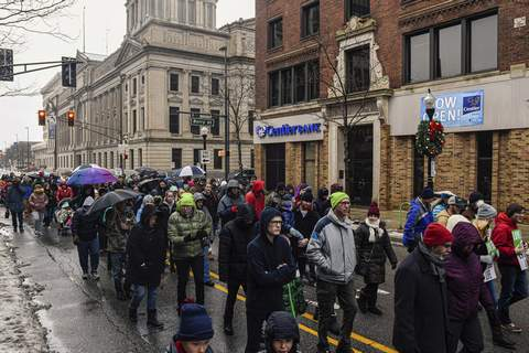 Mike Moore | The Journal Gazette  Protesters march down Calhoun Street on Saturday for the 46th annual March for Life. The peaceful protest is an annual march in opposition to the 1973 Supreme Court ruling that legalized abortion across the country.About 2,000 pro-life citizens from Northeast Indiana attended the march downtown.