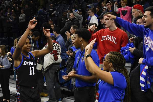 DePaul guard Charlie Moore (11) greets fans after an NCAA college basketball game against Butler Saturday, Jan. 18, 2020, in Chicago. DePaul won 79-66. (AP Photo/Matt Marton)
