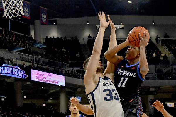 over guard Charlie Moore (11) shoots past Butler forward Bryce Golden (33) during the first half of an NCAA college basketball game Saturday, Jan. 18, 2020, in Chicago. (AP Photo/Matt Marton)