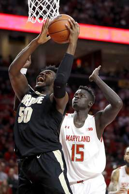Purdue forward Trevion Williams (50) goes up for a shot against Maryland center Chol Marial (15) during the first half of an NCAA college basketball game, Saturday, Jan. 18, 2020, in College Park, Md. (AP Photo/Julio Cortez)