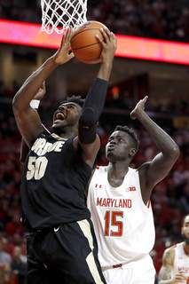 Purdue Maryland Basketball Purdue forward Trevion Williams (50) goes up for a shot against Maryland center Chol Marial (15) during the first half of an NCAA college basketball game, Saturday, Jan. 18, 2020, in College Park, Md. (AP Photo/Julio Cortez) (Julio Cortez