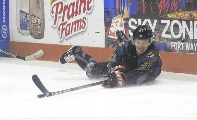 Katie Fyfe | The Journal Gazette  Komets forward Gage Torrel falls to the ice while chasing the puck during the first period against the Toledo Walleye at Memorial Coliseum on Saturday.
