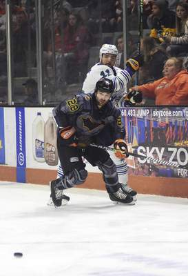 Katie Fyfe | The Journal Gazette  Komets forward Matthew Boudens chases after the puck during the first period against the Toledo Walleye at Memorial Coliseum on Saturday.