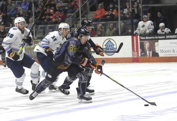Katie Fyfe | The Journal Gazette  Komets forward Alan Lyszczarczyk chases the puck during the second period against the Toledo Walleye at Memorial Coliseum on Saturday.