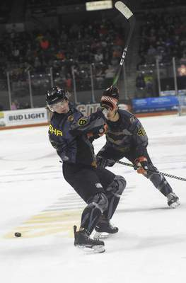 Katie Fyfe | The Journal Gazette  Komets forward Drake Rymsha looks for the puck during the first period against the Toledo Walleye at Memorial Coliseum on Saturday.