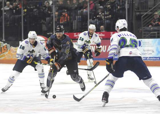 Katie Fyfe | The Journal Gazette  Komets forward Brett McKenzie carries the puck during the second period against the Toledo Walleye at Memorial Coliseum on Saturday.